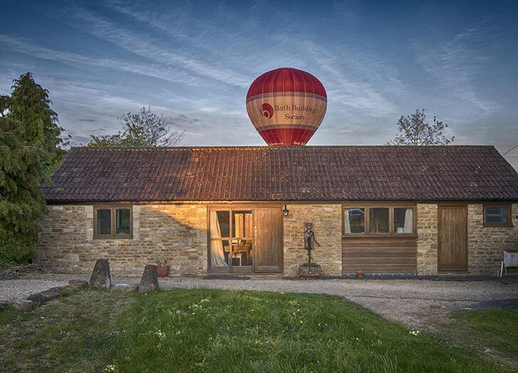 Front of Whitley Coach House with a ballon having just gone over